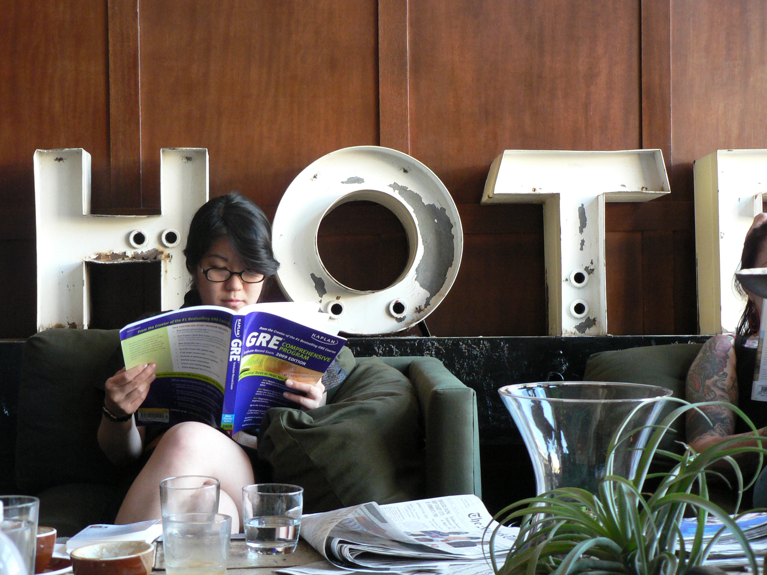 A visitor prepares for college entrance exams in the lobby of Portland's Ace Hotel